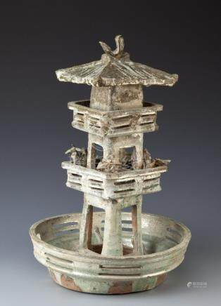 A CHINESE GLAZED POTTERY MODEL OF A TWO STOREY WATCHTOWER HAN DYNASTY With a sloping roof with a