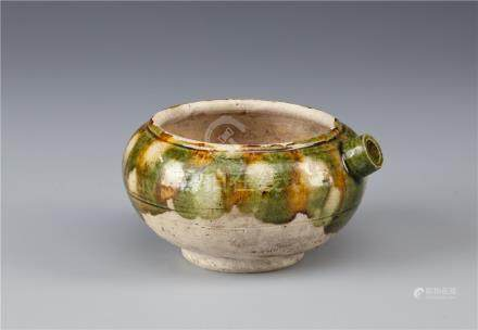 A CHINESE SANCAI WATERPOT TANG DYNASTY With a compressed circular body and spout decorated with a