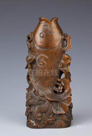 A CHINESE BOX WOOD CARVING OF A CARP QING DYNASTY OR LATER Leaping from rolling waves through