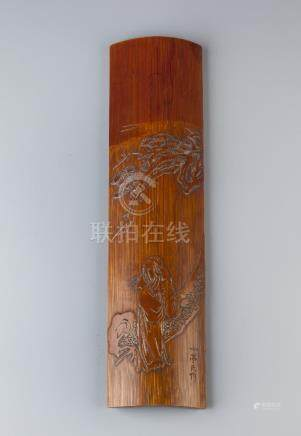 A CHINESE BAMBOO WRIST REST QING DYNASTY OR LATER Carved with a scholar standing beneath a pine