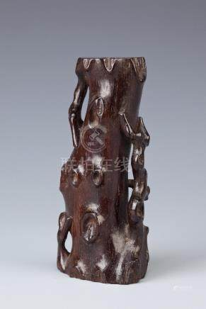 A CHINESE HARDWOOD INCENSE STICK HOLDER LATE QING DYNASTY Carved as a tree trunk with side