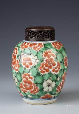 A SMALL CHINESE WUCAI VASE 17TH CENTURY The ovoid body painted in iron-red, aubergine and yellow