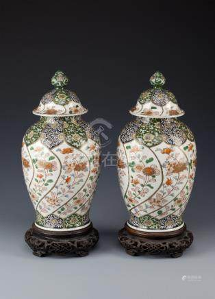 A PAIR OF JAPANESE BALUSTER VASES AND COVERS LATE 19TH CENTURY Each with a short cylindrical neck