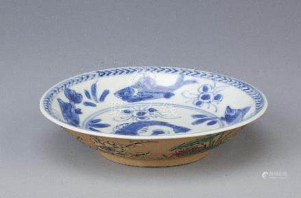 A CHINESE BLUE AND WHITE AND CAFE-AU-LAIT GROUND SAUCER KANGXI 1662-1722 Painted to the interior