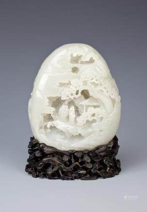 A CHINESE PALE CELADON JADE BOULDER QING DYNASTY OR LATER Carved in high relief with two Immortals