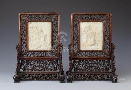 A PAIR OF CHINESE PALE CELADON JADE AND HARDWOOD TABLE SCREENS QING DYNASTY Each carved with figures