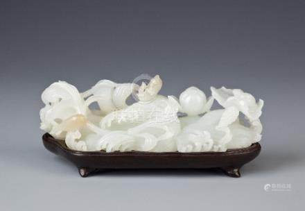 A CHINESE WHITE JADE CARVING PROBABLY LATE QING DYNASTY Finely carved as two fish amidst swirling