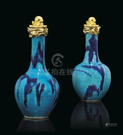 A PAIR OF LOUIS XV ORMOLU-MOUNTED CHINESE BLUE-SPLASHED TURQUOISE GROUND PORCELAIN BOTTLE-VASES
