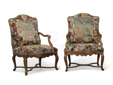 A PAIR OF REGENCE WALNUT FAUTEUILS