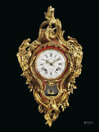A LOUIS XV ORMOLU AND CORNE ROUGE STRIKING CARTEL CLOCK