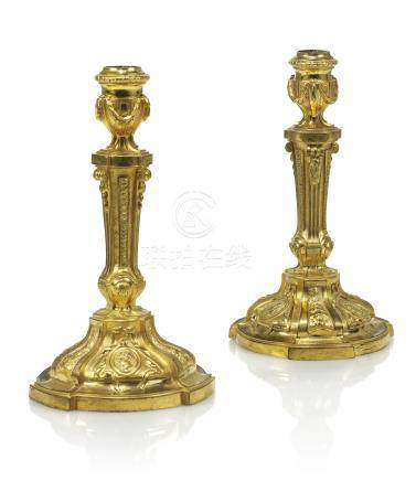 A PAIR OF LATE LOUIS XV ORMOLU CANDLESTICKS