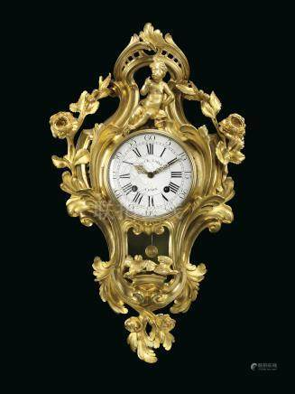 A LOUIS XV ORMOLU STRIKING CARTEL CLOCK