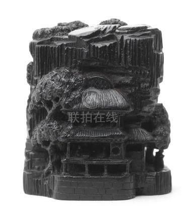 An ebony netsuke of buildings By Chikuyosai Toun, 19th century