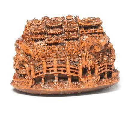 A wood netsuke of a castle By Masamitsu, 19th century