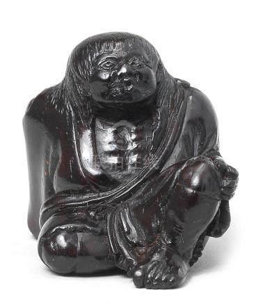 An ebony netsuke of Tekkai sennin By Miwa, Edo, early 19th century