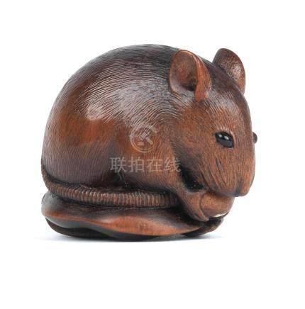A wood netsuke of a rat  By Sari, Iwashiro Province, 19th century