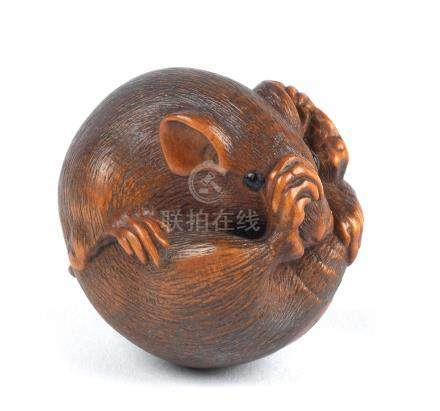 A wood netsuke of a coiled mouse By Masanao, Yamada, Ise Province, 19th century