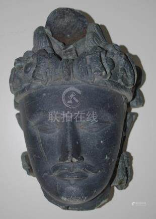 Asian carved stone head