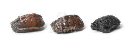 Three wood netsuke of tortoises Edo period, 19th century (3)