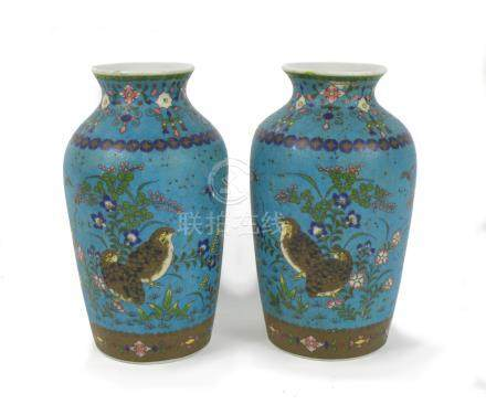 A cloisonné enamel vase and a pair of cloisonné enamel and porcelain vases 19th century (3)