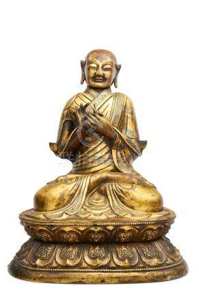 A Sino-tibetan gilt copper alloy repoussé figure of Tsong Kharpa 18th century