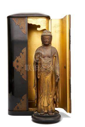 A Japanese gold lacquered wood figure of Amida Buddha Edo period