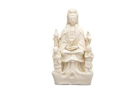 A dehua white glazed figure group of Guanyin and attendants 19th century