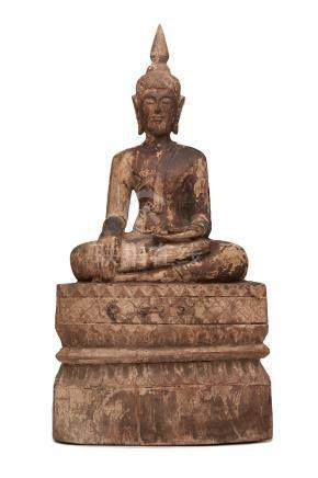 A Lao carved wooden figure of Shakyamuni 19th century
