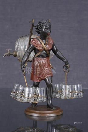 Nubienne portefaix  Sculpture formant nécessaire à liqueur en régule patiné noir, rouge et d