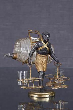 Nubien portefaix  Sculpture formant nécessaire à liqueur en régule patiné noir et doré figur