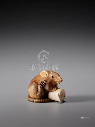 A RARE IVORY NETSUKE OF A RAT WITH CANDLE BY KANO TOMOK…