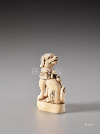 A FINE IVORY SEAL NETSUKE OF A DOG WITH COLLAR AND BELL…