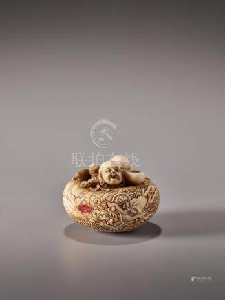 AN UNUSUAL IVORY MANJU NETSUKE WITH TWO MONKS IN AN ALM…