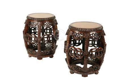 PAIR OF CARVED HUANGHUALI AND BURRWOOD BARREL STOOLS, QING DYNASTY