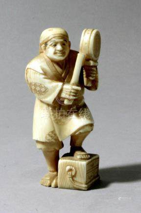 An early 20th century Japanese school. A carved ivory figure