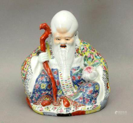 20th century Chinese school. A porcelain figure of Buddha