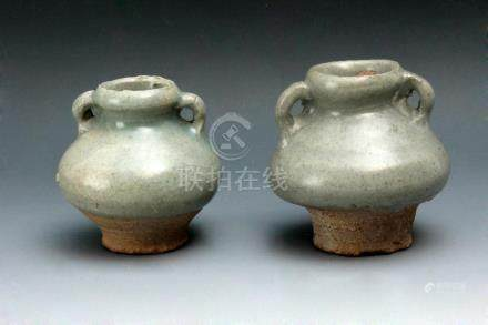A pair of 17th century Chinese glazed pottery vases from the