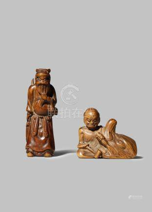 TWO JAPANESE WOOD NETSUKE EDO/MEIJI PERIOD One carved as the Chinese general Kan'u stroking his