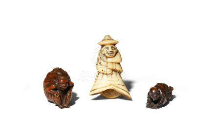 THREE JAPANESE NETSUKE EDO/MEIJI PERIODS Two in wood, one carved as an oni carrying a large sack