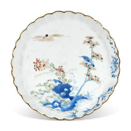 A CHINESE UNDERGLAZE BLUE AND POLYCHROME ENAMELLED FOLIATE DISH MING DYNASTY (17TH CENTURY)