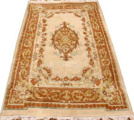 "INDO-CHINESE HAND WOVEN RUG W 3'10"" L 6'"