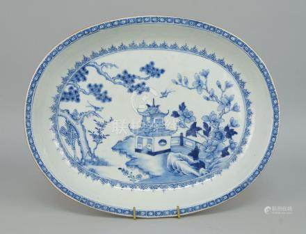 A Chinese export blue and white porcelain oval dish, 18th century, decorated with buildings and