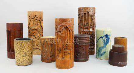 Four Chinese bamboo pots, mid 20th century and later, decorated with carved scenes, various sizes,