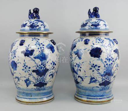 A pair of Chinese blue and white porcelain baluster jars and covers, late 20th/early 21st century,