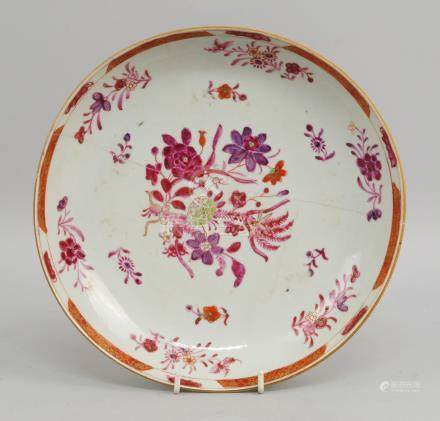 A Chinese famille rose porcelain dish, 18th century, decorated with a central spray of flowers and