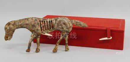 A Chinese metal model of a horse, possibly from Ordos, Mongolia, in an antique manner, 12cm high (
