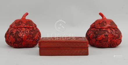 A pair of Cinnabar lacquer gourd shaped boxes with covers, 20th century, decorated with trailing