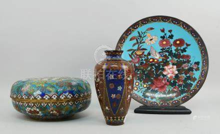 A Chinese enamel box and cover, late 19th/early 20th century, decorated with a centre panel of a