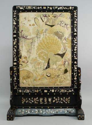 A Chinese hardwood and mother of pearl inlaid table screen, 19th century, the main panel with silk