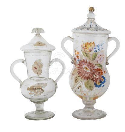 Two similar Turkish glass twin handled vases with covers, late 19th century, both decorated with